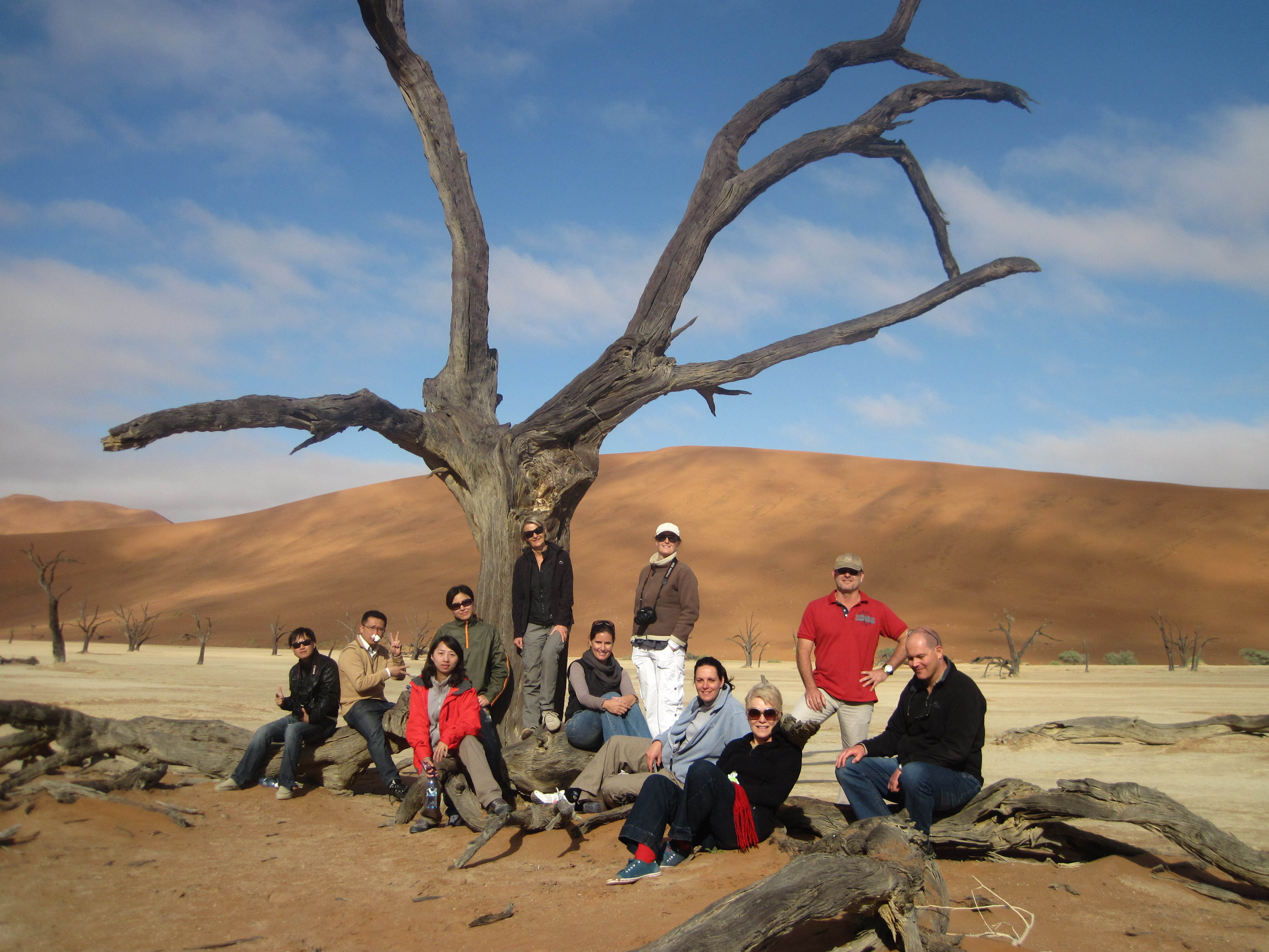 An overlanding group at the Dead Vlei, Namibia