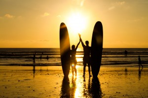 Bali couple surfing Kuta 121528228