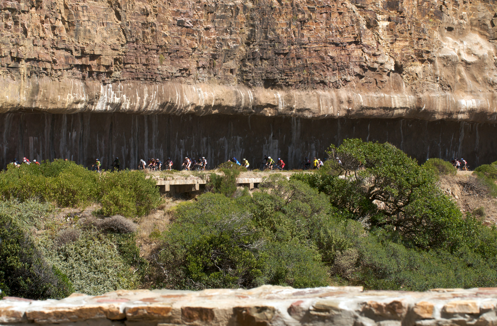 Cyclists pass through a tunnel on Cape Argus