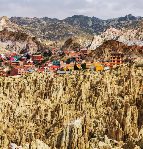 The Valley of the Moon, with colourful houses in the backdrop, near La Pas, Bolivia