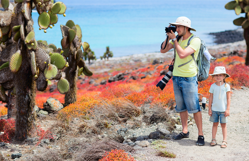 Father with son taking pics in the Galapagos Islands, Ecuador