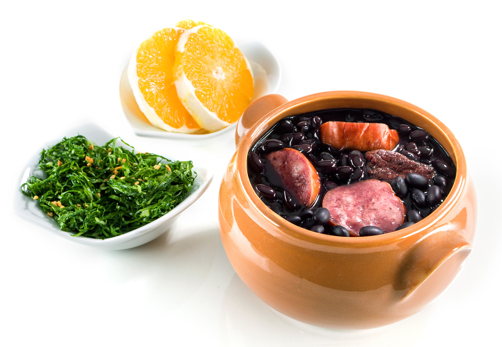 Feijoada, Collard greens and orange slices.