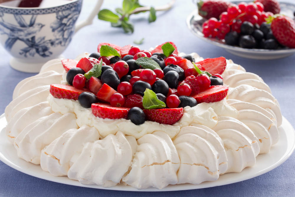 Pavlova with cream and berries