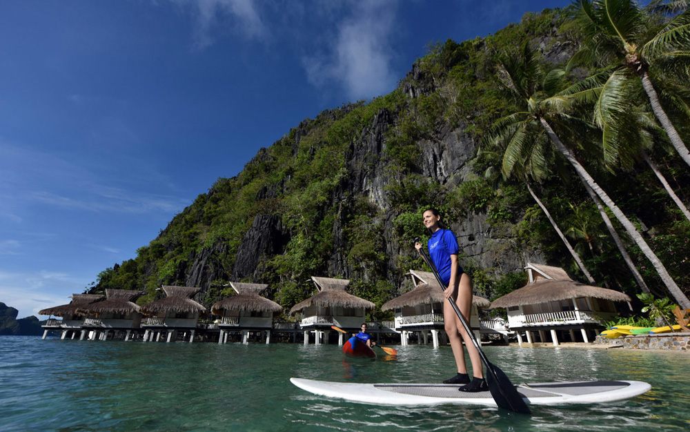 Stand-Up Paddle Boarding at El Nido Miniloc Island Resort, Philippines