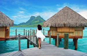Woman Tahiti over water bungalows French Polynesia 90136030