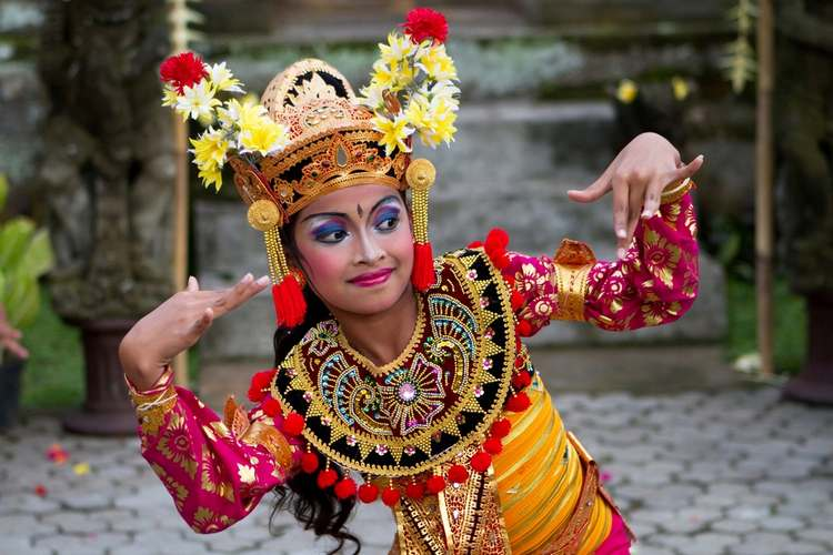 Balinese girl performs a welcome dance in Ubud