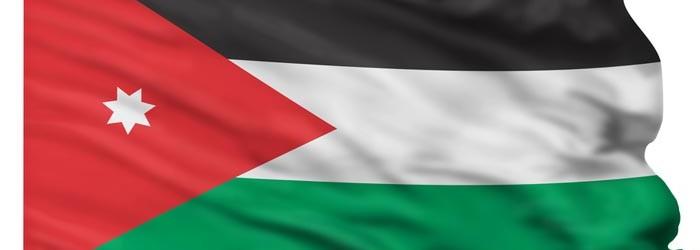 Flag of Jordan flying high in the sky