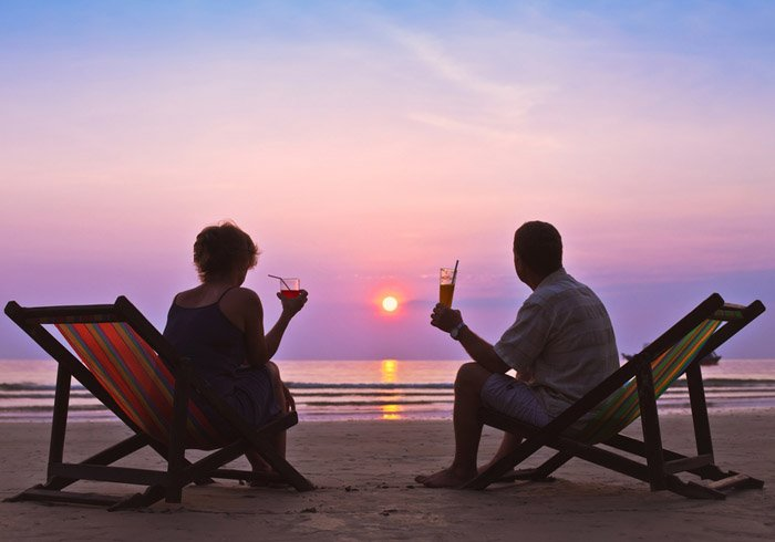 Couple on the beach with drink