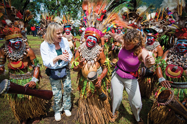 Tribal dancers and tourists, Papua New Guinea