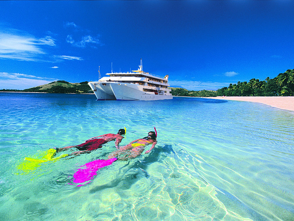 Snorkellers in Front of Fiji Princess