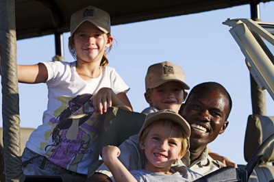Kids on jeep with guide