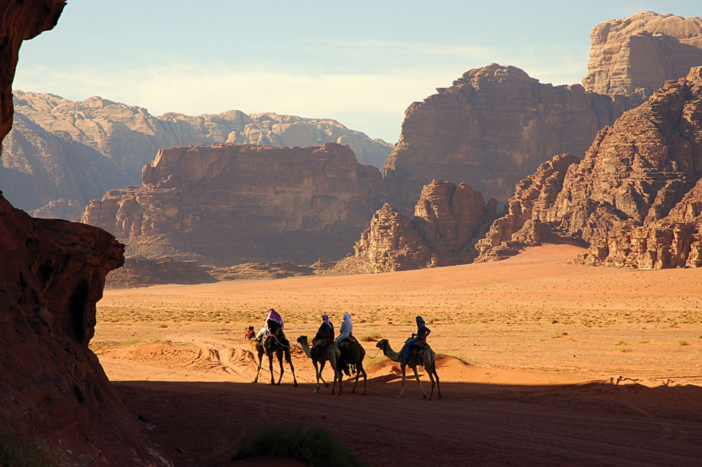 Taking a camel ride through Wadi Rum, Jordan