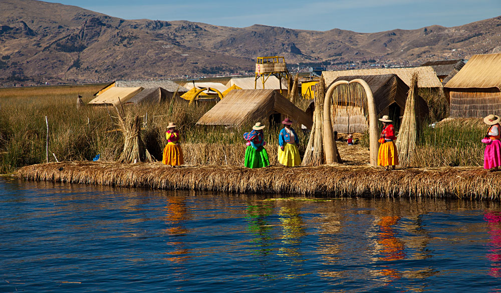 Floating island and locals, Lake Titicaca