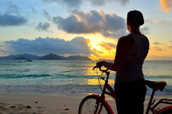Admiring La Digue beach at twilight