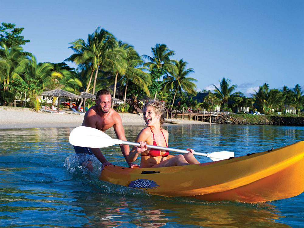Couple kayaking in Savaii