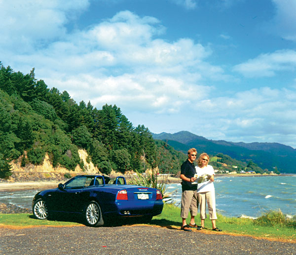 Couple with Car and Map, New Zealand