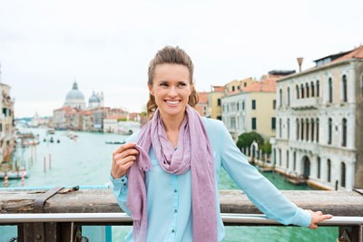 Elegant Woman Tourist Holds Scarf and Smiling, Venice, Italy_314298872