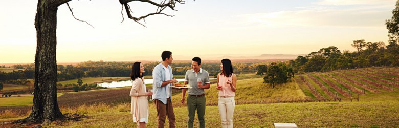 Friends Enjoying a Picnic with Wine in Hunter Valley, Australia