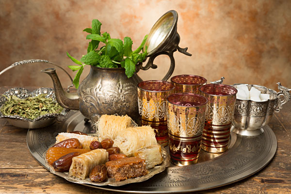 Honey pastries and dates on a Moroccan tea tray