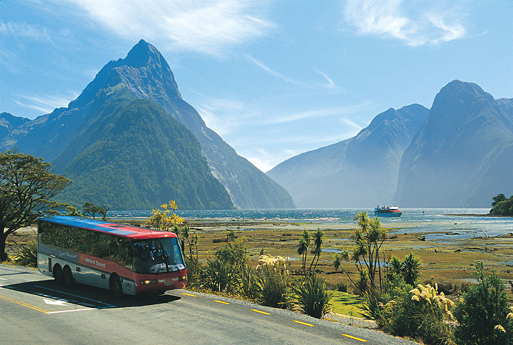 Motorcoach and Milford Mariner at Milford Sound, New Zealand