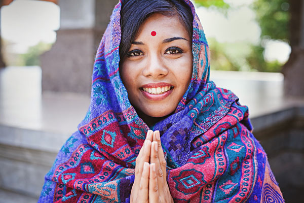 Nepalese Indian Woman Offering Namaste Greeting, India_312312932