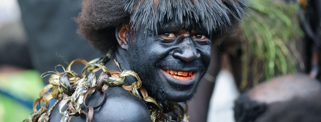 Black painted tribesman, Papua New Guinea