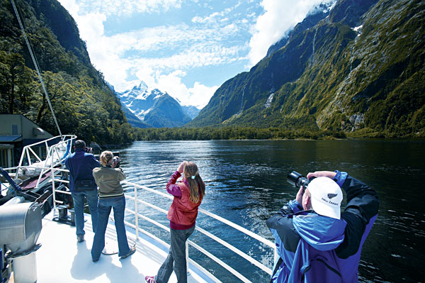Passengers photographing Milford Sound's beautiful scenery, New Zealand