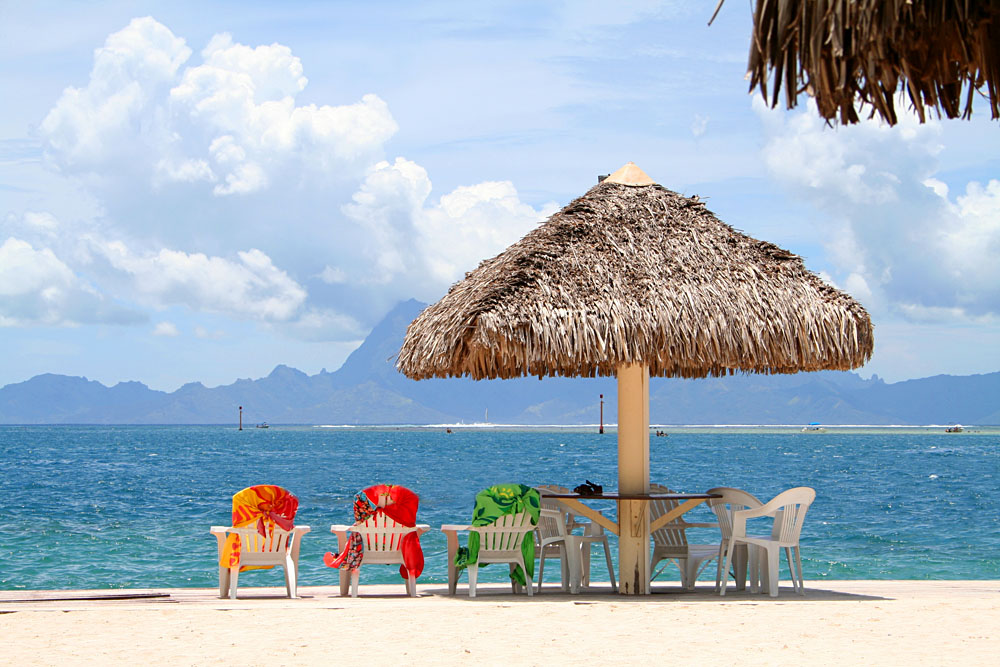 Three Colorful Chairs Aligned on a Beach in Papeete, Tahiti, French Polynesia