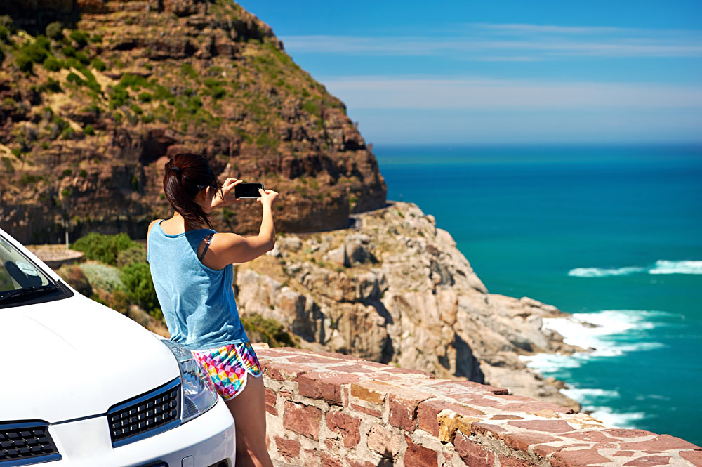 Taking a photo at Chapman's Peak, South Africa