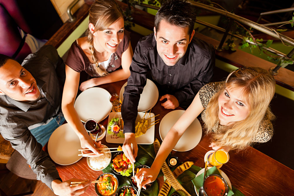 Young People Eating in a Thai Restaurant