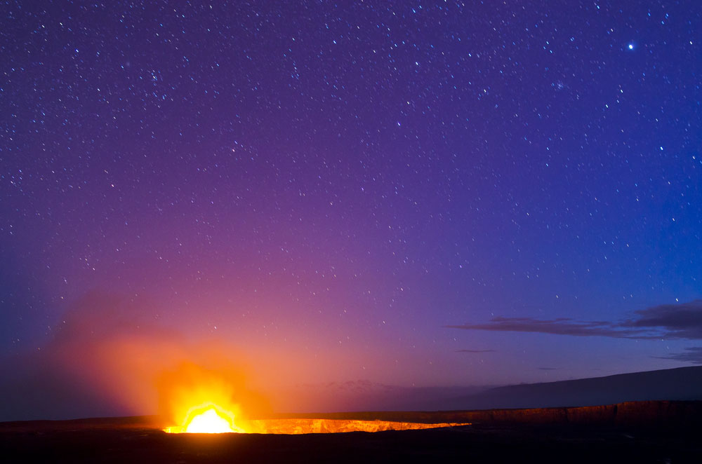 Kilauea Volcano glows under a starry night sky on the Big Island of Hawaii