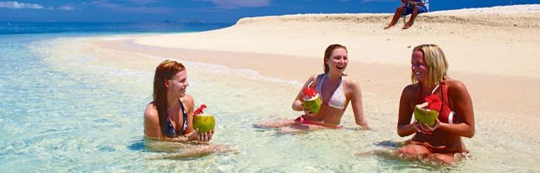 Women Enjoying the Water on a Fiji Beach