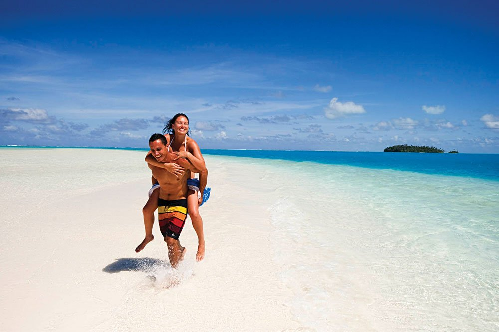 Young Couple on Aitutaki Lagoon Beach, Cook Islands