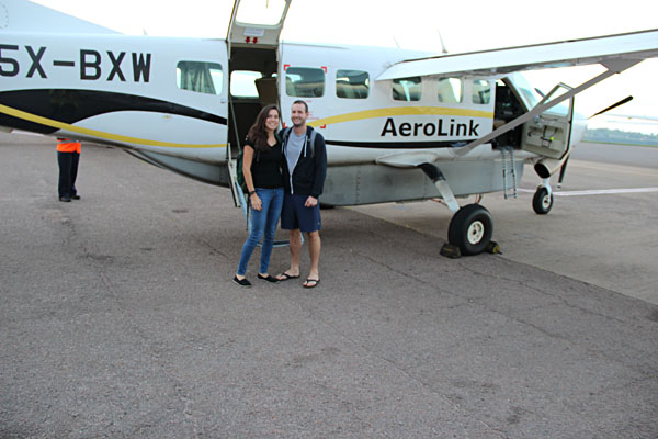 Bronwyn and Husband in Front of Small Plane, Uganda