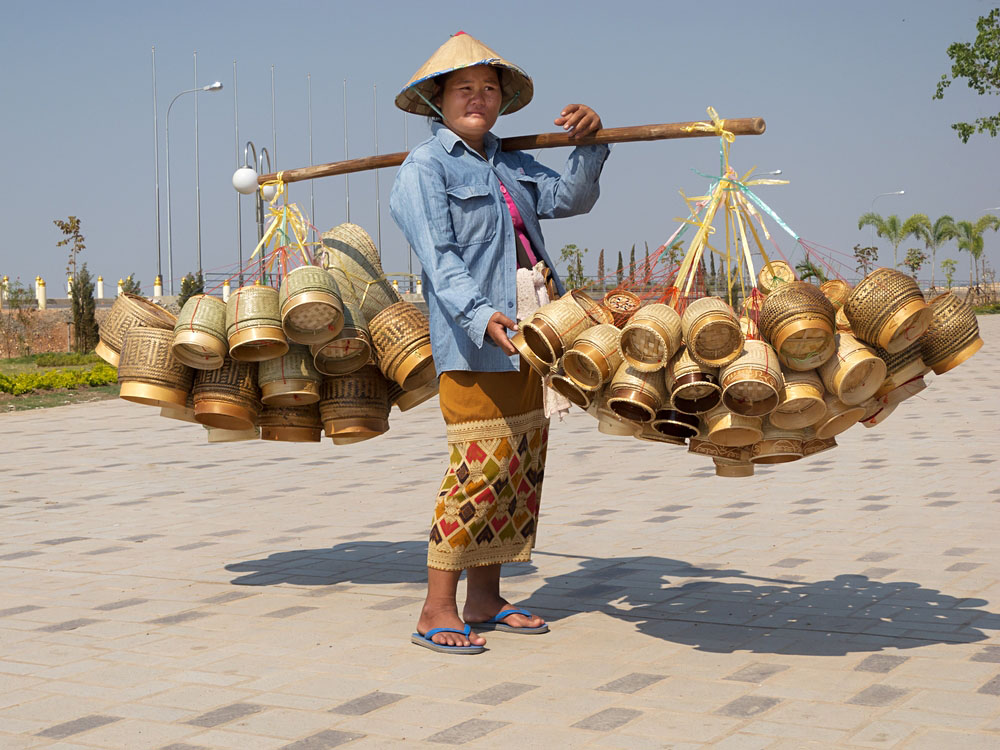 Traditional Woman Selling Wares in Asia