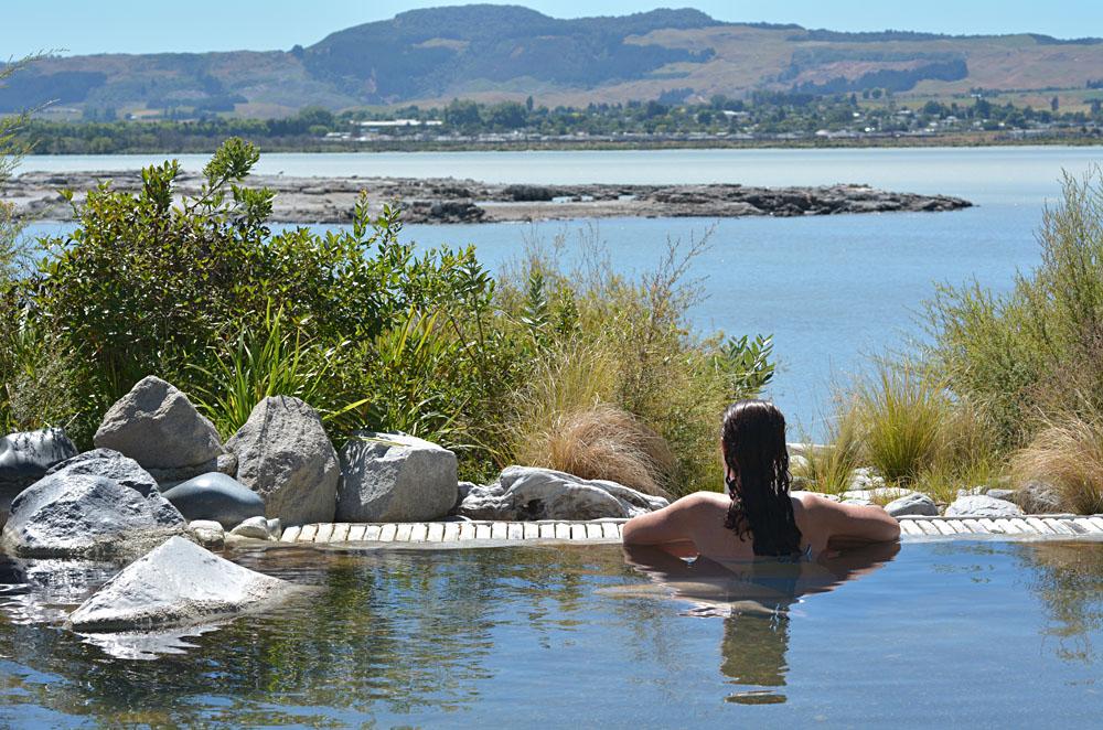 Woman Relaxing in Hot Pool in Rotorua, New Zealand