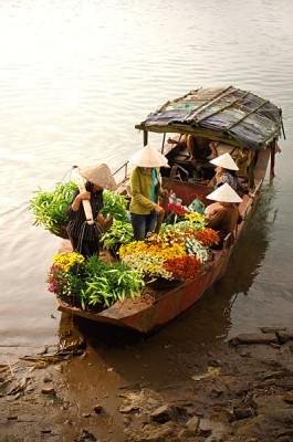 Women Selling Flowers on a Boat, Vietnam