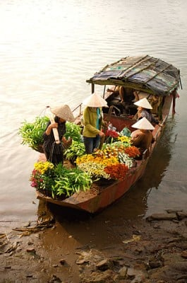 Women Selling Flowers on a Boat, Vietnam