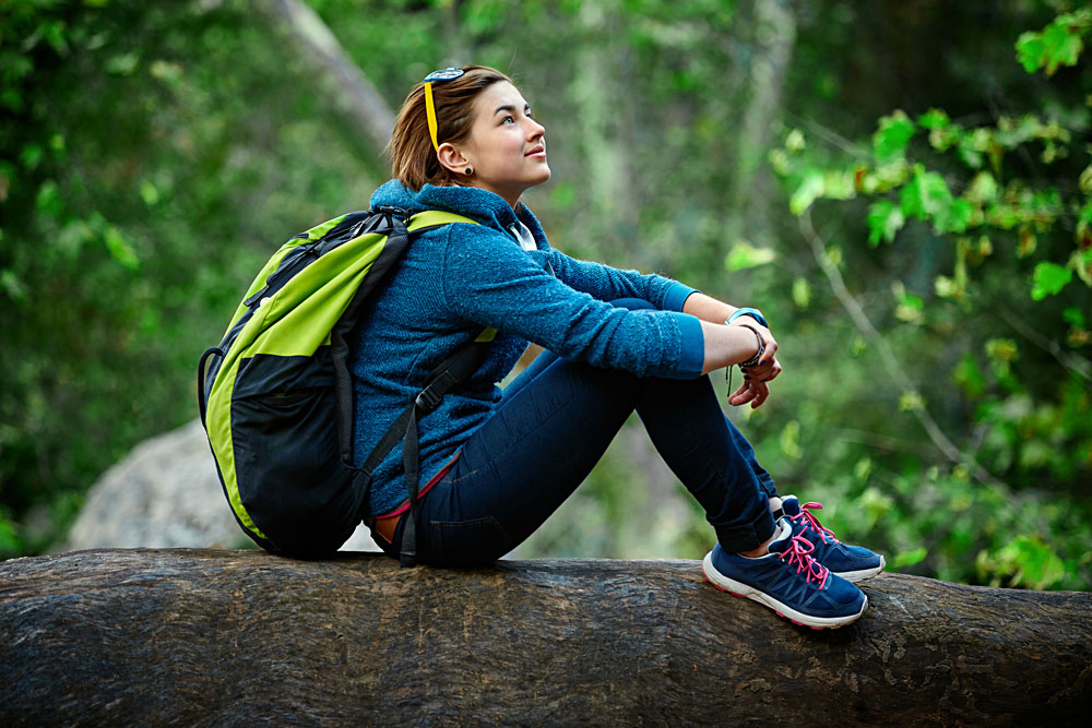 Active Healthy Female Hiker Resting in Beautiful Forest