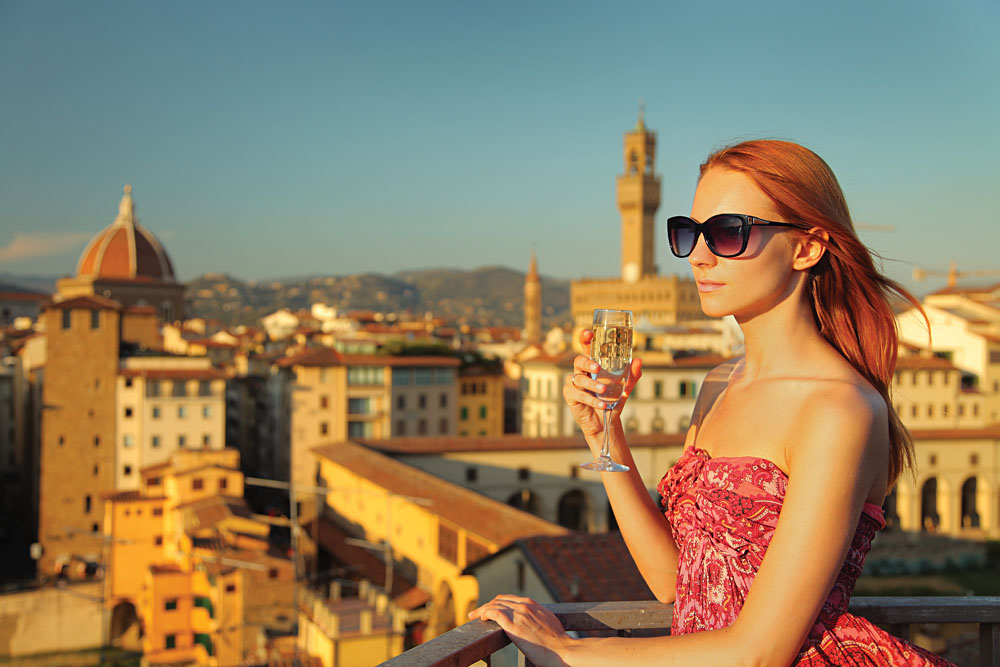 Beautiful Woman with Glass of White Wine in Florence, Italy