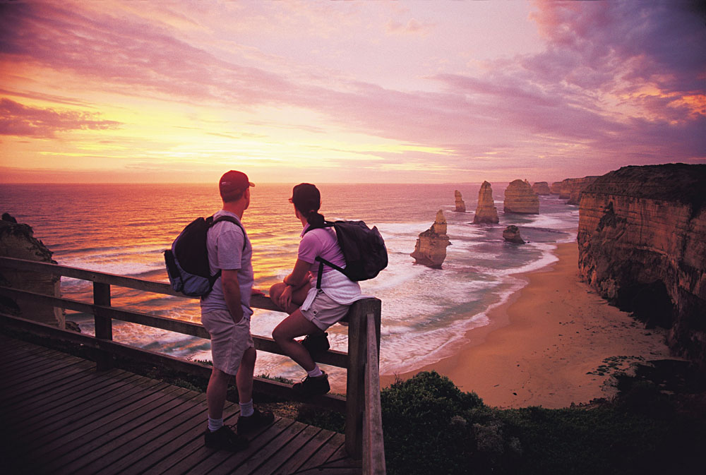 Couple Looking Out at the Twelve Apostles at Sunset, Victoria, Australia
