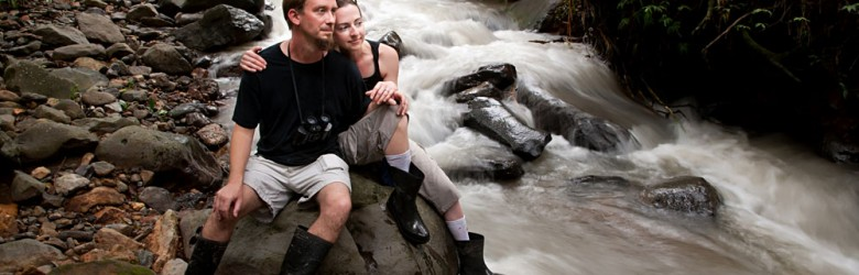 Couple Relaxing Near River, Costa Rica