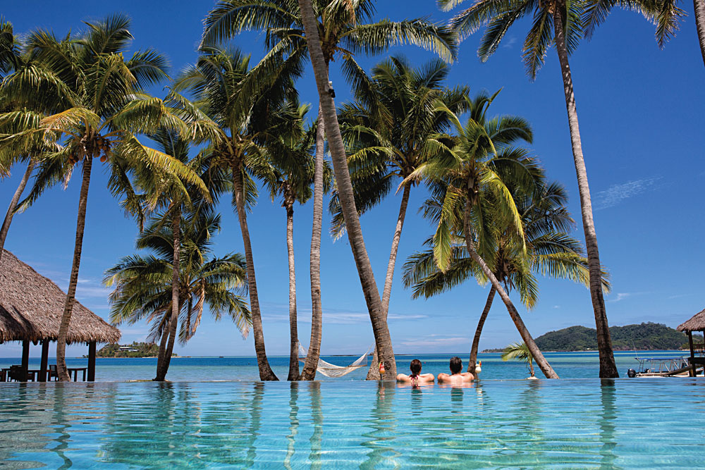 Couple Relaxing in Pool, Tropica Island Resort, Mamanuca Islands, Fiji