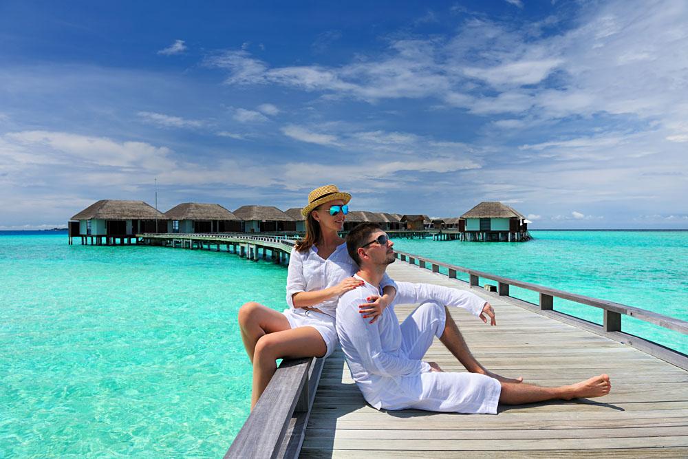Couple on a Tropical Beach Jetty, Maldives
