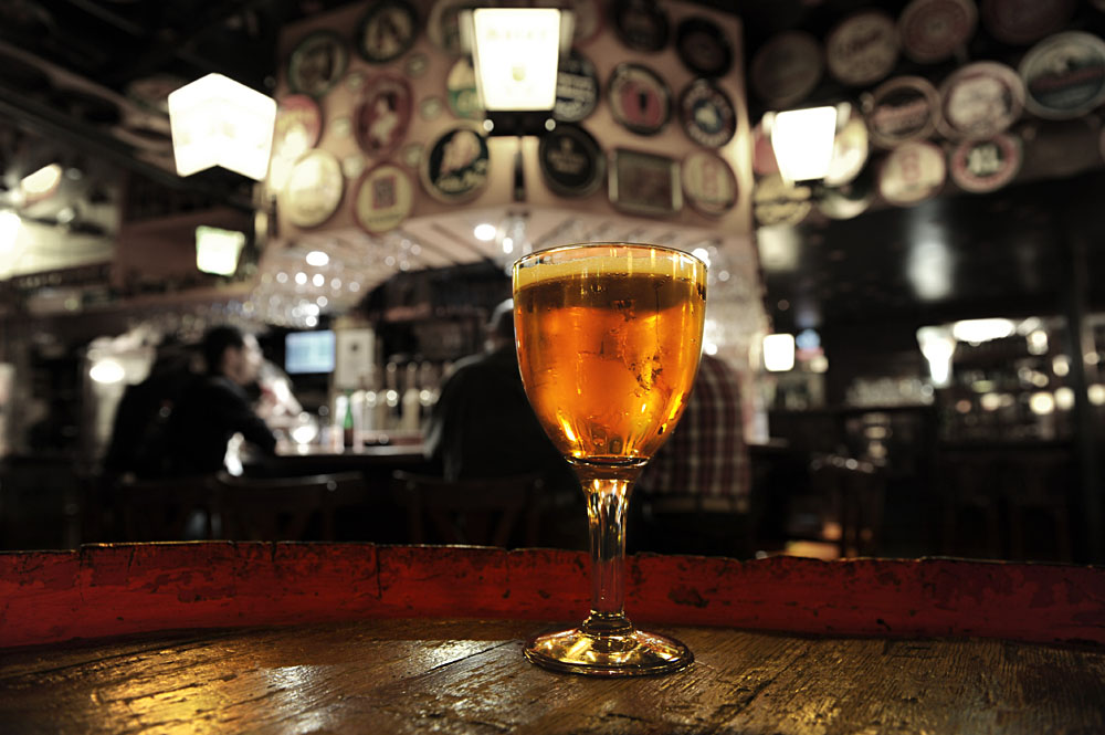Glass of Fresh Beer at Delirium Cafe bar in Brussels, Belgium
