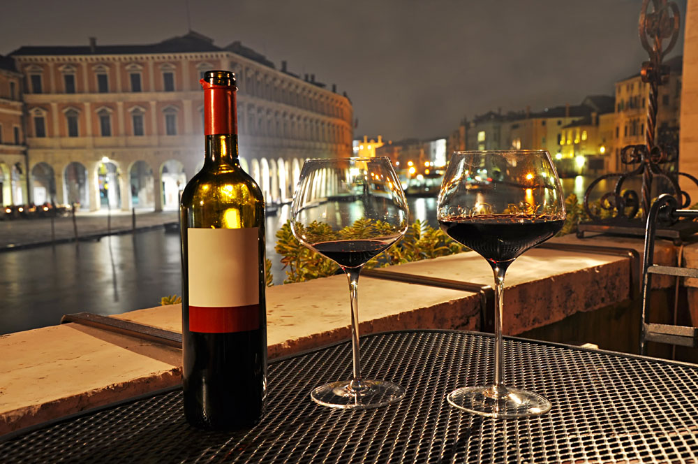 Glasses and Bottle of a Red Wine in Venice, Italy, Italy