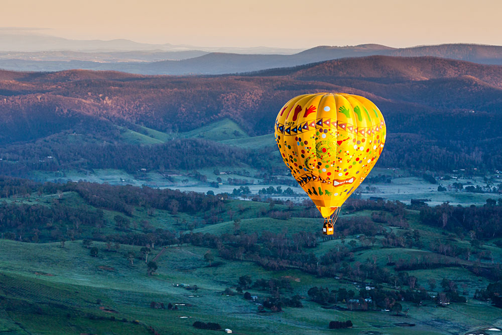 Hot Air Balloon Flight at Sunrise Over the Yarra Valley in Victoria, Australia