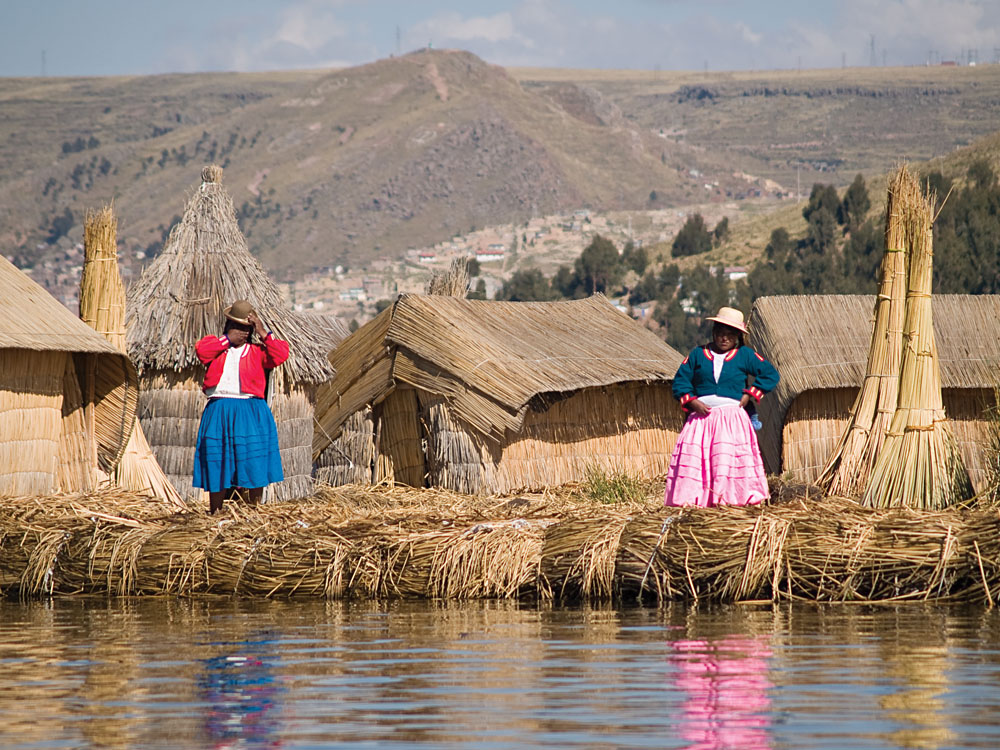 Local Women in Floating Uros Island on Lake Titicaca, Peru