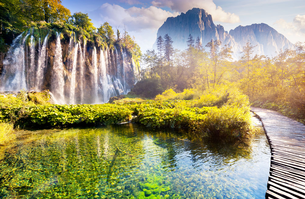 Majestic Waterfalls in Morning Light at Plitvice Lakes National Park, Croatia