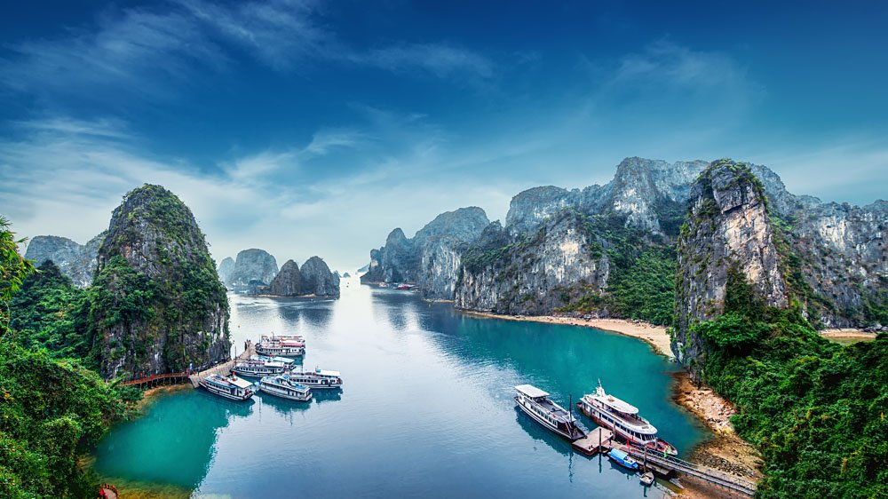 Tourist Junks Floating Among Limestone Rocks at Halong Bay, Vietnam